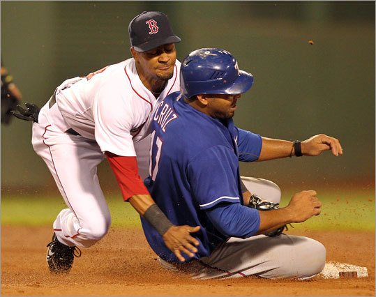 Second baseman Eric Patterson tagged out Rangers runner Nelson Cruz in the fifth inning after Cruz tried to advance when a pitch got away from Red Sox catcher Kevin Cash. Cash recovered the ball in time to catch Cruz.
