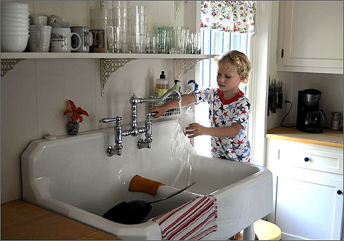 James' son Callum, 4, got a drink of water in the kitchen. Curriers have been spending summers on The Ridge since 1876, and in recent years the family has struggled to hold onto their vacation cottage.