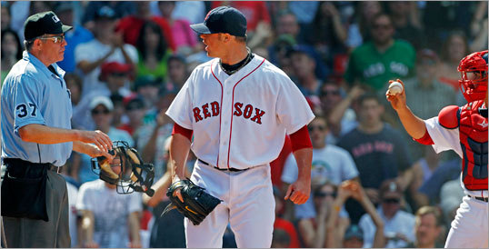 The call set off Red Sox pitcher Jon Lester, who protested while Cash showed the ball to the umpire Darling.