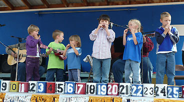 "Hold that tune The sleepy mountain hamlet of Yellow Pine, Idaho, 150 miles north of Boise, swells from 40 residents to upwards of 3,500 people in August during the annual Yellow Pine Harmonica Contest and Festival . Amateur and professional harmonica players from around the world gather to entertain and compete in the town that bills itself as ""the harmonica capital of the western world.'' ""It's self-regulating because there aren't any Hiltons around and you have to like camping,'' says festival chairman Steve Holloway. ""We have just one general store, one restaurant, a bar, and a lodge.'' Your campsite will overlook high mountains and the East Fork of the South Fork of the Salmon River. When you're not taking in the toe-tapping music, go whitewater rafting, fishing, or hiking in the wilderness."