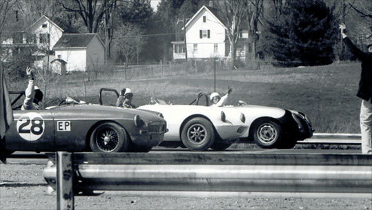Drivers signal to an official that they're ready to start the race at Lime Rock Park.