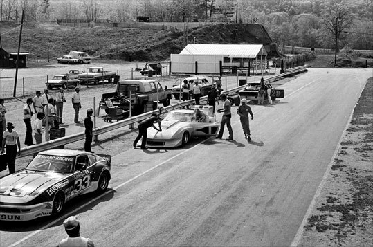 Two cars get a quick inspection in pit lane in 1978.