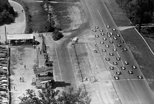 This historic overhead shot shows cars lining up as drivers prepare to gear up for a race.