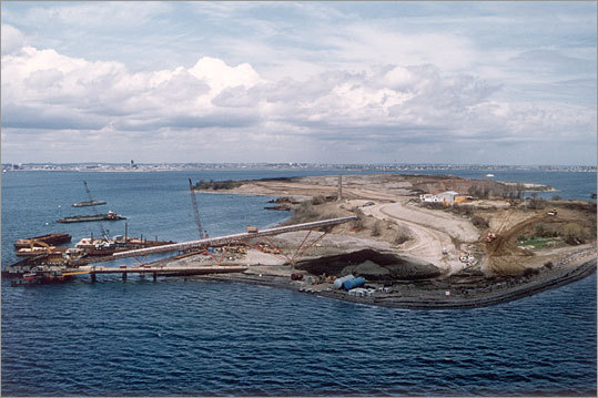 In the early 1990s, the Legislature had a different problem: What could the state do with 3.5 million cubic yards of excavated material, mostly dirt and gravel, from the Big Dig? Officials decided to merge Boston's biggest public works projects, the Big Dig and harbor cleanup, and cover Spectacle Island with 2 to 5 feet of topsoil. Here, construction in progress in 1993.