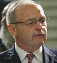 Former House speaker Salvatore F. DiMasi and three codefendants are facing federal corruption charges.