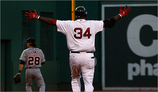 Boston Red Sox designated hitter David Ortiz raises his arms as he strides into 2d base after hitting a game-winning, bases-clearing double in the ninth inning.