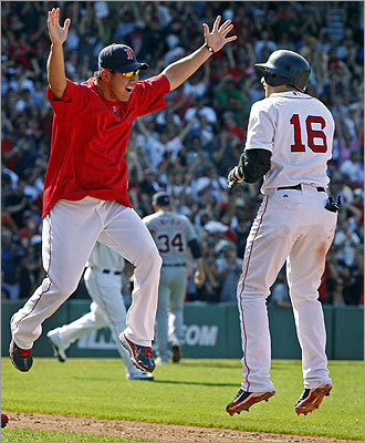 Daisuke Matsuzaka (left) leaps to greet an already airborne Scutaro after the winning run crossed the plate for the Red Sox.