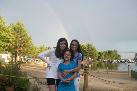 Julia, Olivia, & Jodi, from Revere, pose in front of a rainbow at Point Sebago, Maine after a brief rainstorm.