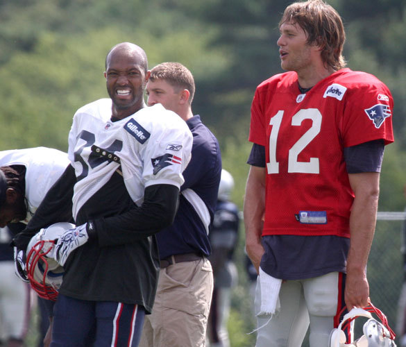Torry Holt and Tom Brady chat during training camp.