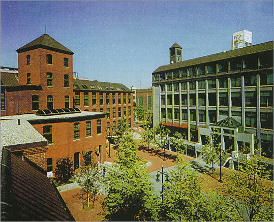 1990 - Move to Cambridge The company moves its headquarters to Kendall Square in Cambridge. Pictured: Courtyard and building behind One Kendall Square in Cambridge