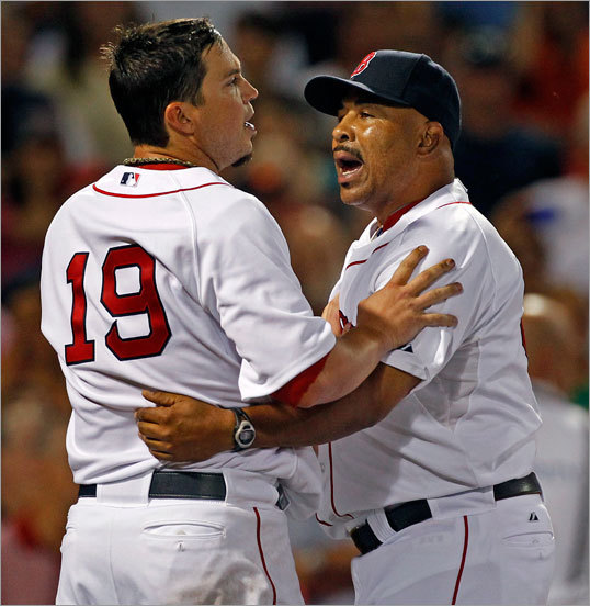Beckett was restrained by bench coach DeMarlo Hale during the eighth-inning melee.
