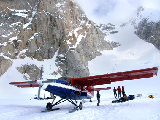Paul Roderick loads his turbo-prob Otter on the Root Canal Glacier, a landing which he pioneered. Roderick is one of only a few pilots who are willing to land in this tight cirque.
