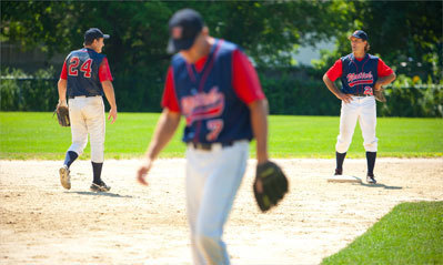 The three Flutie brothers: Doug (at right, 2nd base); Darren (far left, shortstop) and Bill (foreground, 3rd base).