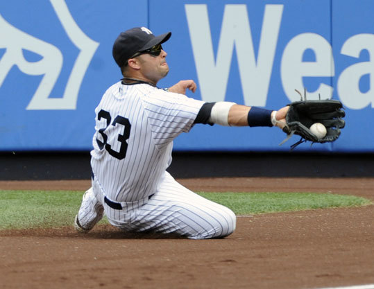 Yankees right-fielder Nick Swisher made a sliding catch during the second inning.