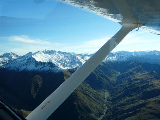 The view while flying through the New Zealand Alps in a small Cessna is breathtaking.