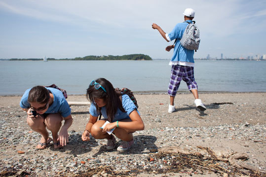 """The smooth, worn fragments are the focus of an amateur archeology course the nonprofit group Save the Harbor/Save the Bay is launching as part of its island outings for thousands of urban youths each summer. """"You go into the environment and grab something like this,'' Bruce Berman, architect of the group's youth programs, said as he held a chunk of porcelain on the island's beach yesterday. """"If you wonder what it is enough and do a little bit of research, you can actually find out. And that teaches critical-thinking skills that are extremely important to the successes of the kids we work with.''"""