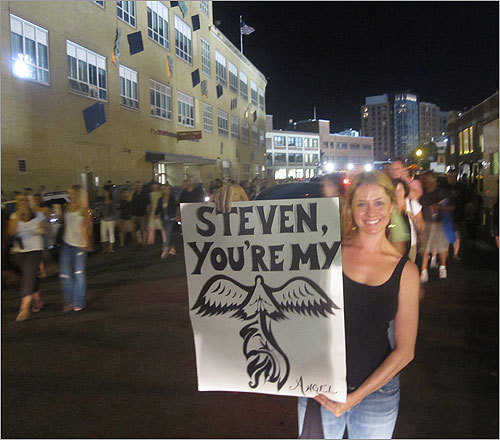 Tiffany Popoli of Boston posed outside Fenway with a hand-made sign expressing her devotion to singer Steven Tyler.