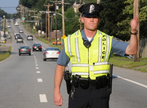 Officer Ron Poirier directs traffic after an accident on Route 9.