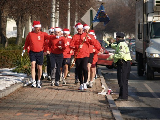 Wellesley officers participate in their annual Holiday Fun Run on Dec. 23, 2005.