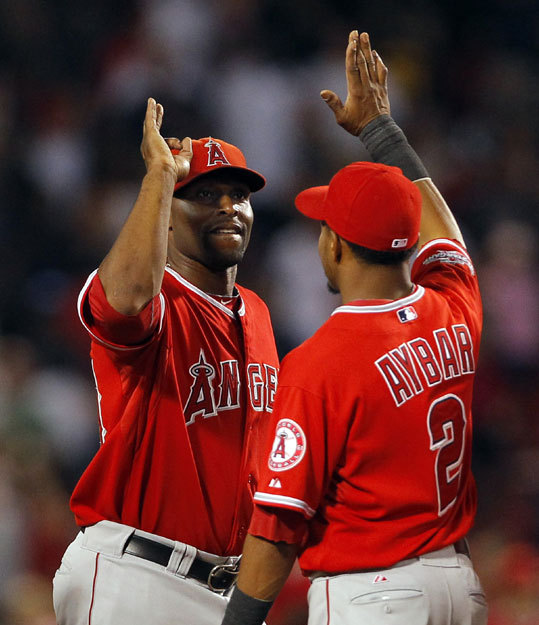 The Angels finally beat the Red Sox, 7-2, after losing all nine of the previous matchups this season. Right fielder Torii Hunter (left) and Erick Aybar celebrated the win which pulled the Angels back to .500.