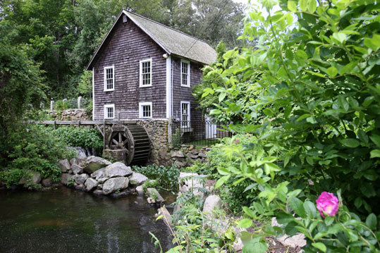 The grist mill on Stony Brook Road stands on its original 1663 site and uses the force of the water from several ponds to grind fresh cornmeal on Saturdays in the summer.