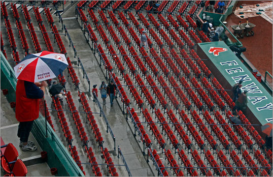 The start of Sunday's game was delayed by rain, so fans were slow to fill Fenway's soggy seats.