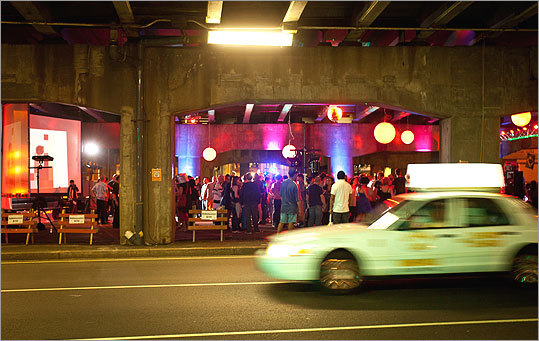 Cars pass by the Project MUM party under the McGrath Highway.