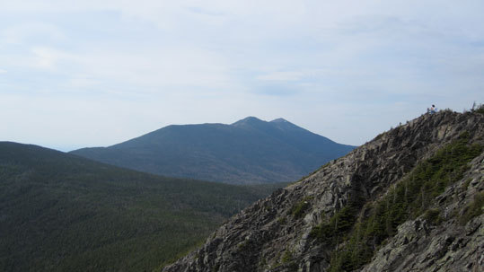 Rick Tucker is barely visible (far right on the rocky summit of Mt. Flume) in this photo taken in June near Franconia, N.H. The picture also captures Mt. Lafayette and Franconia Ridge in the background.