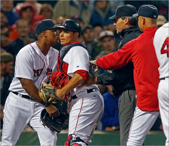 Catcher Kevin Cash and umpire Angel Hernandez kept Adrian Beltre away from home plate umpire Dan Bellino (not pictured) after he was ejected from the game between the second and third innings. Red Sox manager Terry Francona joined the action to argue the call.