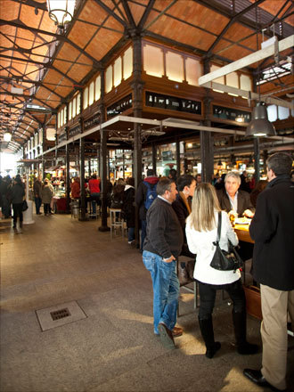Madrid's recently-refurbished Mercado San Miguel, where tapas is served all day next to fresh market offerings.