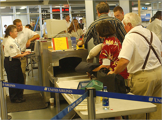 September 2002: Massport hires retired Army colonel Dennis Treece to be its first director of corporate security. November 8, 2002: TSA completes staffing Logan's security checkpoints, replacing private company employees. Left: Federal employees at work inspecting luggage and passengers in Logan's Terminal C in 2002.