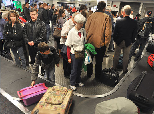 Aug. 1, 2010: Nationwide, all cargo traveling in passenger planes required to be screened. Aug. 19, 2010: The TSA rolls out its enhanced pat-down method in Boston in which agents slide the front of their hands down passengers' bodies, including the groin area. Left: Passengers wait for their bags.