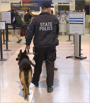 1970: Sky marshals start flying on select flights after Palestinians hijack several American planes. 1973: Metal detectors are installed in US airports after several US airliners are hijacked to Cuba. Bomb-sniffing dogs arrive at Logan International Airport. Left: State Police Sgt. Jay Staples and his dog Kizer patrol Logan Airport in this 2003 photo.