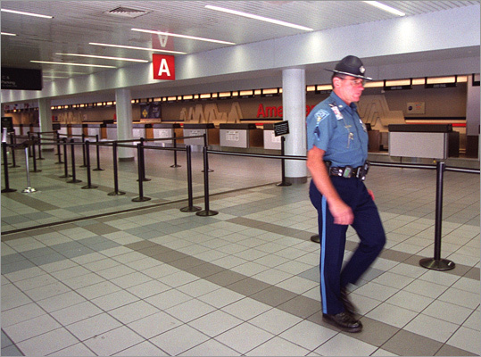 Sept. 11, 2001: Using utility knives, Al Qaeda terrorists hijack four planes, two originating out of Logan, and fly them into the World Trade Center, the Pentagon, and a field in Pennsylvania. Left: A state trooper patrols the empty American Airlines terminal on Sept. 11, 2001, after the airport was shut down.