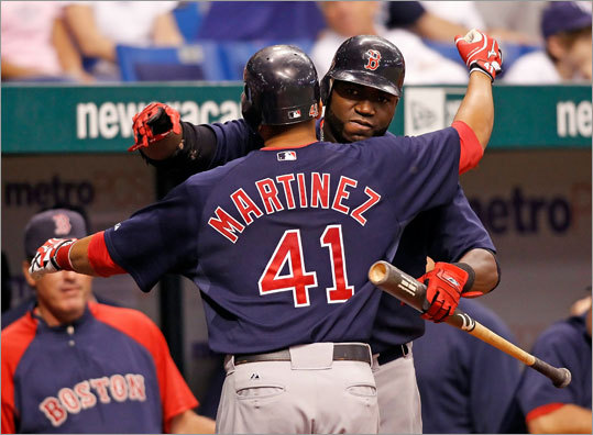 Victor Martinez was congratulated by David Ortiz after his first inning home run against the Tampa Bay Rays Friday.