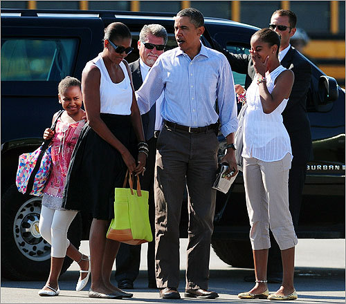 President Barack Obama, First Lady Michelle Obama, and their daughters Malia and Sasha prepared to board Marine One, bringing their 2010 Martha's Vineyard vacation to an official end. Click through this gallery to see how the Obamas spent their island vacation.