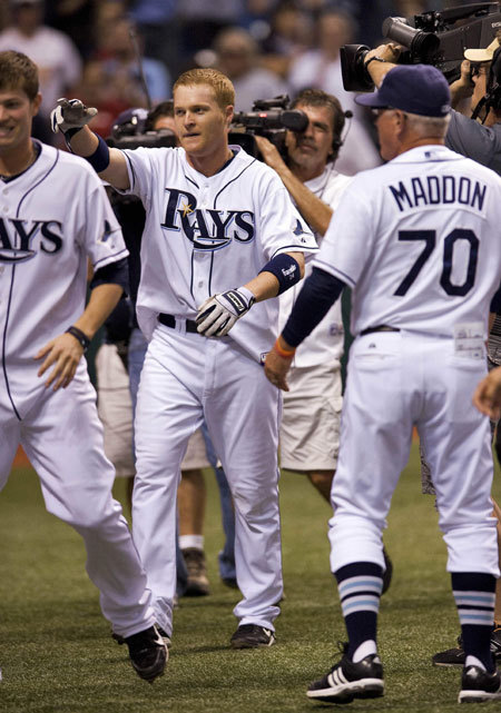 Designated hitter Dan Johnson led off the bottom of the 10th inning with a walk-off home run off Scott Atchison to give the Rays a 3-2 win over the Red Sox. It was Johnson's second of the season.