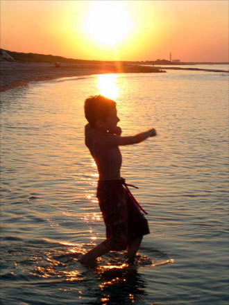 Dawn, from Newton, took this photo of Kevin skipping rocks at his uncle's beach in Sandwich.