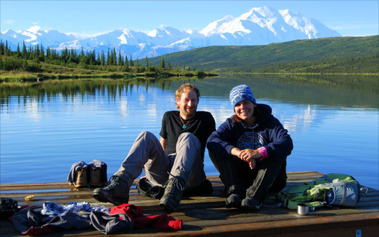 Katy Giorgio, of Jamaica Plain, shares a thermos of white tea on Wonder Lake, in Denali National Park, with a backpacker from Switzerland.
