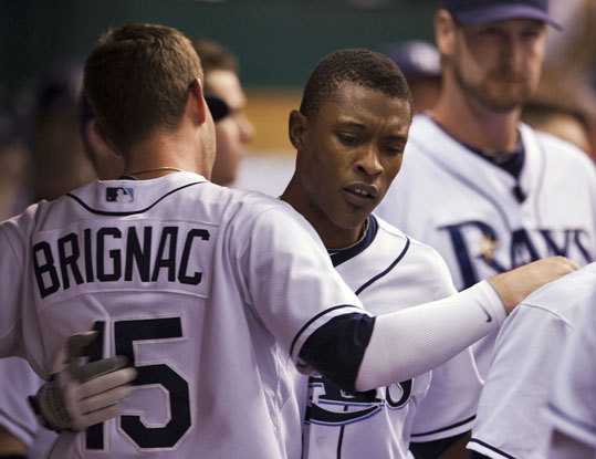 Rays outfielder BJ Upton (center) was congratulated by Reid Brignac after he tagged Clay Buchholz for a solo home run in the 8th inning.