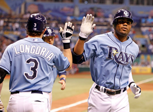 Rays outfielder Carl Crawford (right) was congratulated by Evan Longoria (left) after hitting a two-run-home run of fJohn Lackey in the sixth inning that tied the game at three.