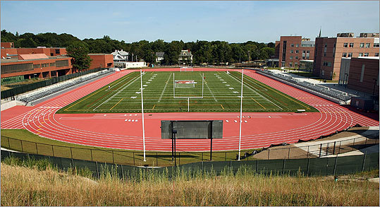 An image of the new athletic field behind the school. The old school can be seen on the left.