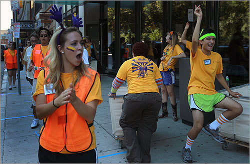 In keeping with tradition, students danced to music while helping with the move in front of the dorms.