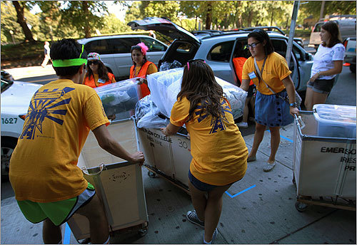 Emerson students dressed in school colors helped incoming students move in.