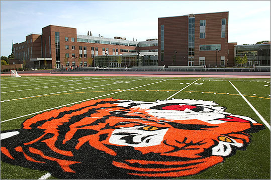At left, a photo of the new athletic field behind the school, complete with the school mascot.