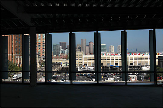 Views of the Boston skyline can be seen through the windows of the unfinished building.