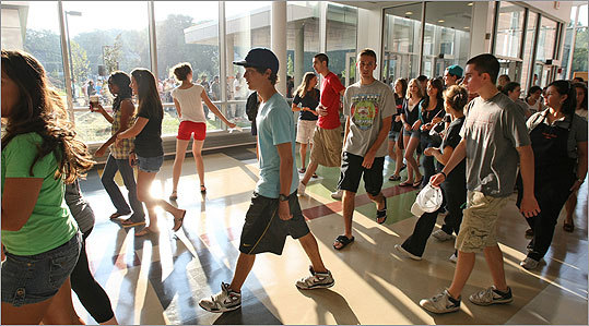 Returning seniors were the first to enter the new school this morning, with the rest of the audience following.