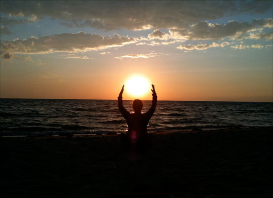 John Sommerstein took this picture of his wife 'holding the sun' on Duck Harbor Beach in Welfleet.