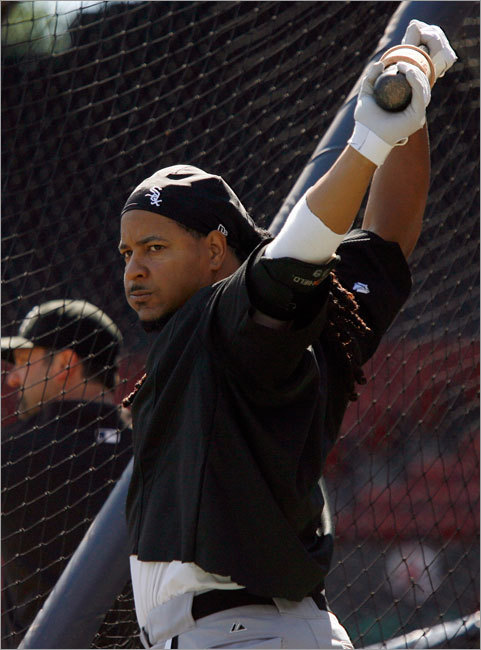 Manny Ramirez stretched out before taking batting practice prior to the start of the first of a twin bill with Red Sox Saturday at Fenway Park.