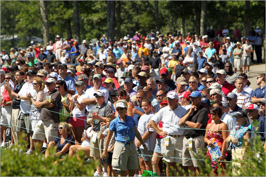 A large crowd watched Tiger Woods along the 18th fairway.